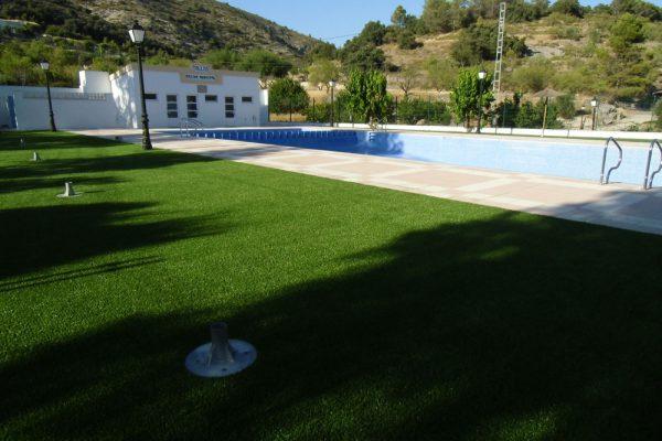 Gazon synthétique pour jardins comme élément décoratif